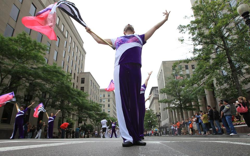 Gary Ende with the Lesbian and Gay Big Apple Corps color guard twirled a flag during the Boston Pride Parade.