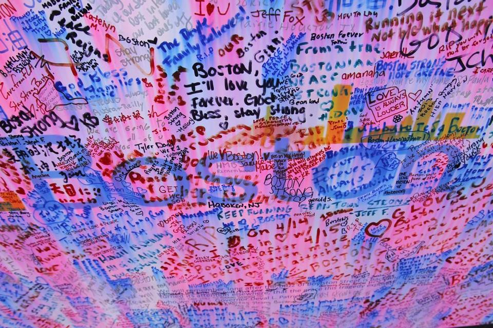 Messages at a memorial for the victims of the Boston Marathon bombings.