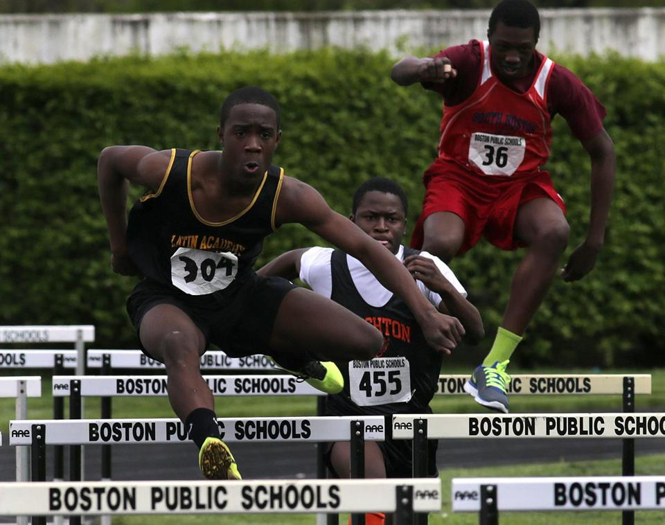 Latin Academy's Xavier Hill shows excellent form en route to winning the 110-meter hurdles at White Stadium.