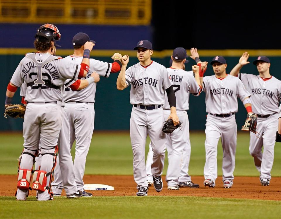 The Red Sox celebrated after a 9-2 win over the Rays.