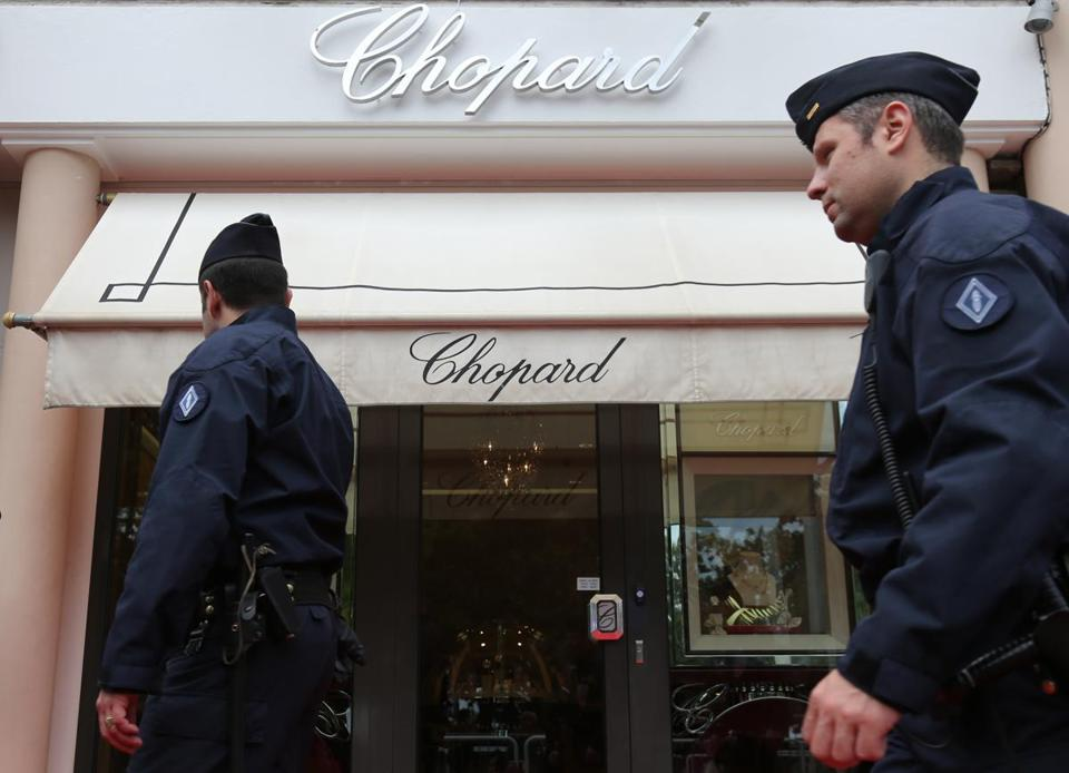 Police officers patrolled outside a Chopard store in downtown Cannes after jewelry worth more than one million dollars made was stolen at the Novotel Hotel during the 66th edition of the Cannes Film Festival in Cannes.
