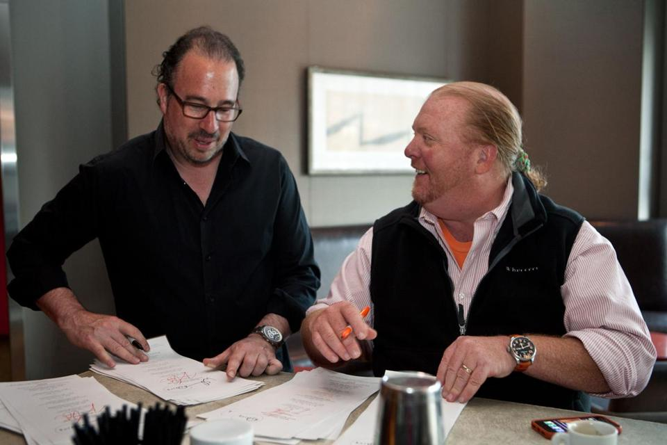 Radius chef/owner Michael Schlow (left) and N.Y. chef Mario Batali sign menus for guests before the party.