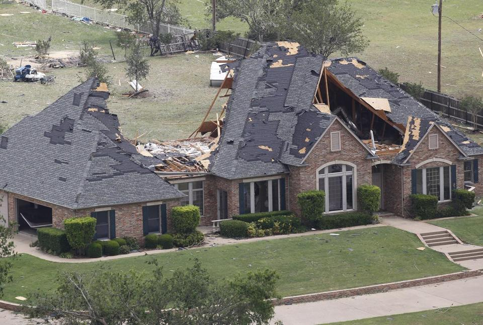 Portions were missing from the roof of a house in Cleburne, Texas, following tornadoes.