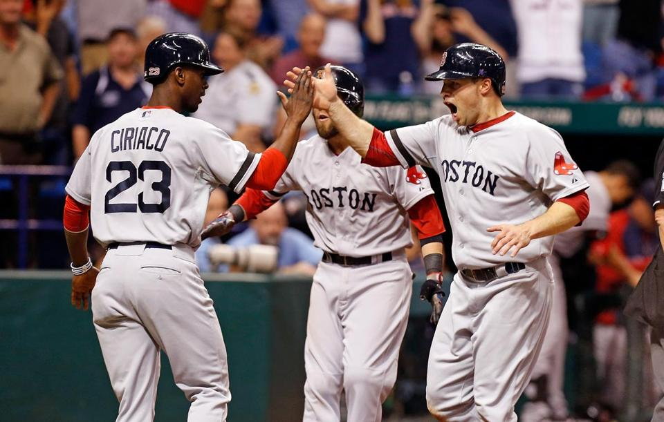 Pedro Ciriaco, left,  and Daniel Nava celebrated after they scored with Dustin Pedroia on a three-run double by Will Middlebrooks in the ninth inning.