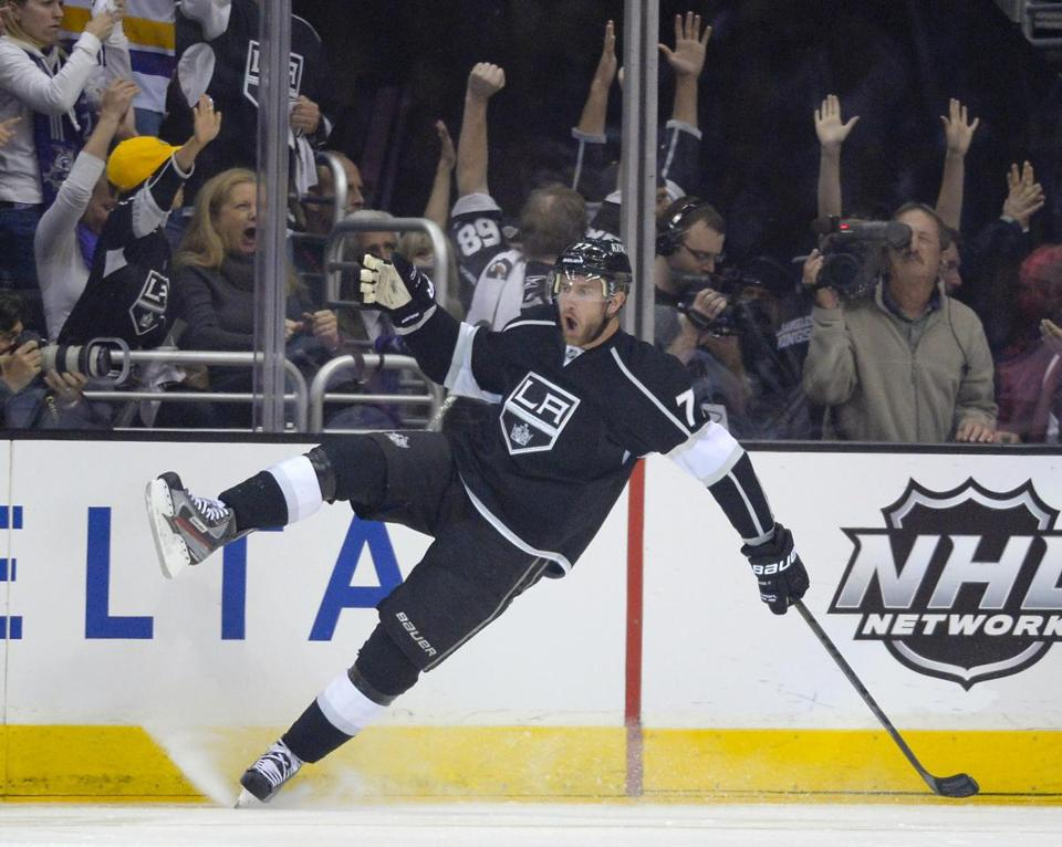 Jeff Carter celebrates after scoring in the first period. He later assisted on the tying goal late in the third period.
