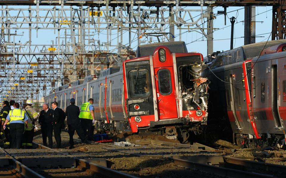 Emergency personnel worked at the scene where two Metro-North commuter trains collided.