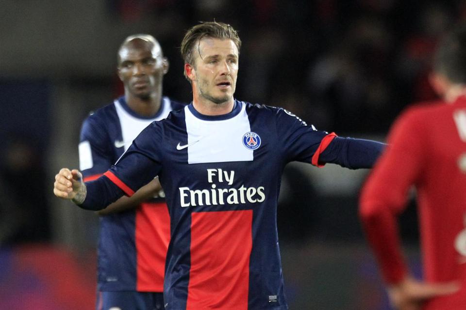 A teary David Beckham leaves the field during his last home game for Paris Saint-Germain.