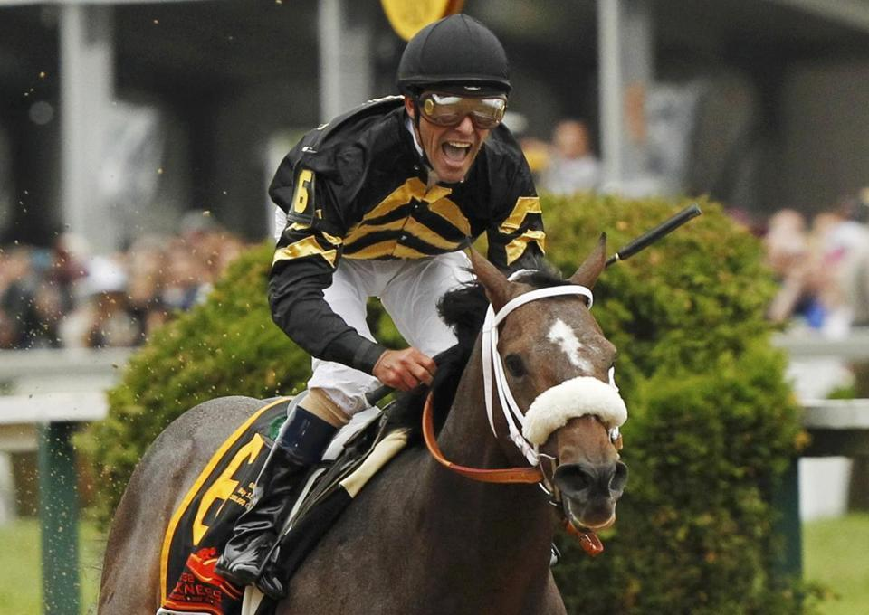 Gary Stevens rides Oxbow to an upset in the Preakness, going wire-to-wire for his third career win in the race.