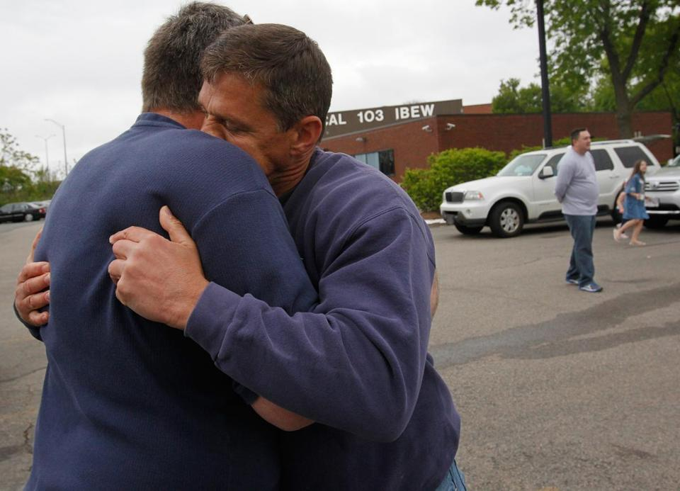 Larry Hittinger (left) and Michael Ward embraced after reconnecting for the first time since the Boston Marathon.