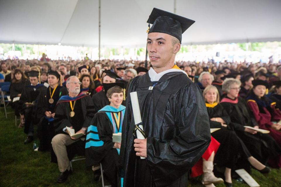 Robert Wheeler of Marshfield held his diploma at Framingham State University's commencement ceremony Sunday.  Wheeler was recognized during the ceremonies for his actions helping a victim of the Boston Marathon bombings last month.