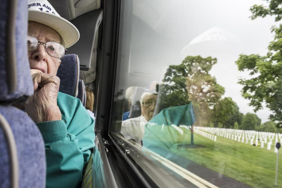 Robert Dorrington of Weston looked out the window at Arlington National Cemetery on Sunday.