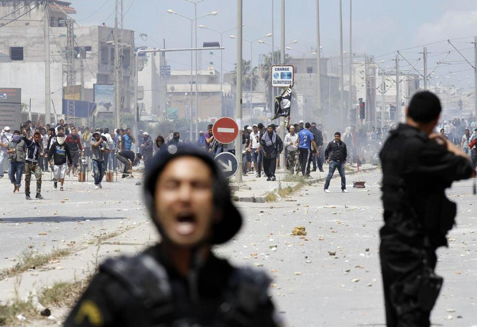 Riot police clashed with supporters of the Islamist group Ansar al-Shariah in Tunis on Sunday.
