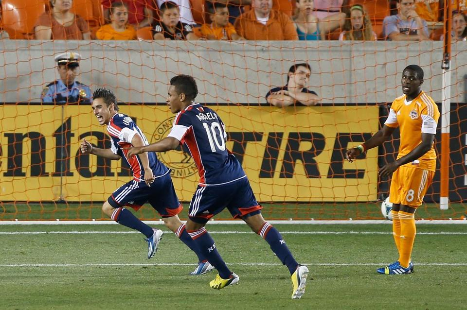Diego Fagundez (left) and Juan Agudelo look for a place to celebrate Fagundez's second-half score.
