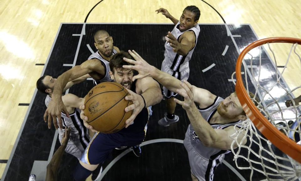 Memphis center Marc Gasol goes up for a shot with four Spurs closing in during Game 1 action in the West finals.