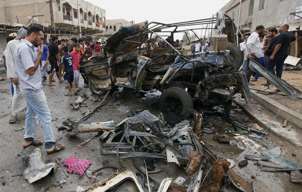 Baghdad was particularly hit hard Monday, with ten car bombs, including one in an eastern area, targeting Shi'ite shops.