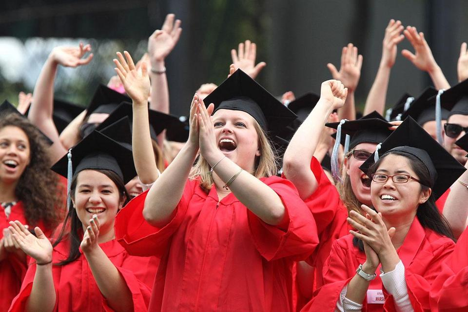 Graduates cheered at Boston University, one of several schools holding commencement exercises Sunday, with celebration tempered by thoughts of the Marathon bombings.