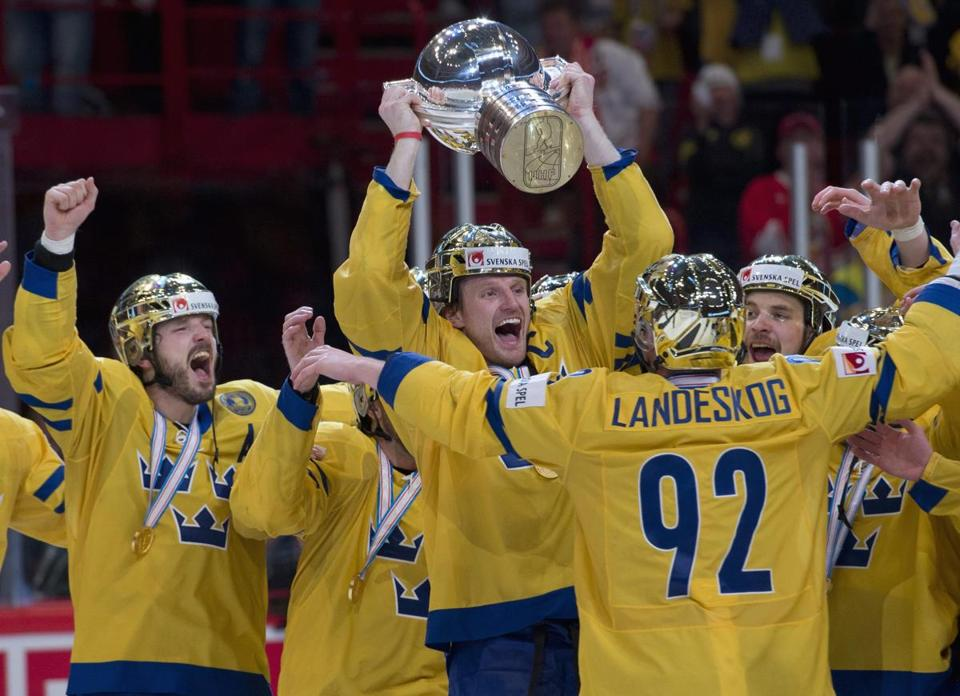 Sweden captain Staffan Kronwall hoists the world championship trophy in Stockholm.
