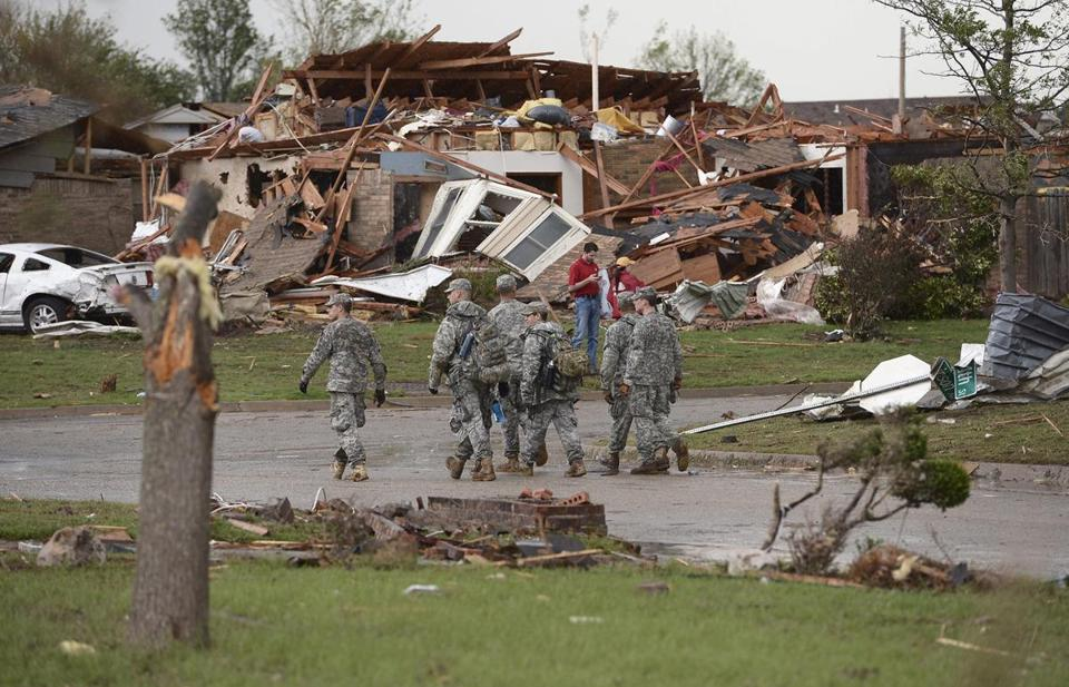 National Guard troops walked through a destroyed neighborhood in Moore, Okla.
