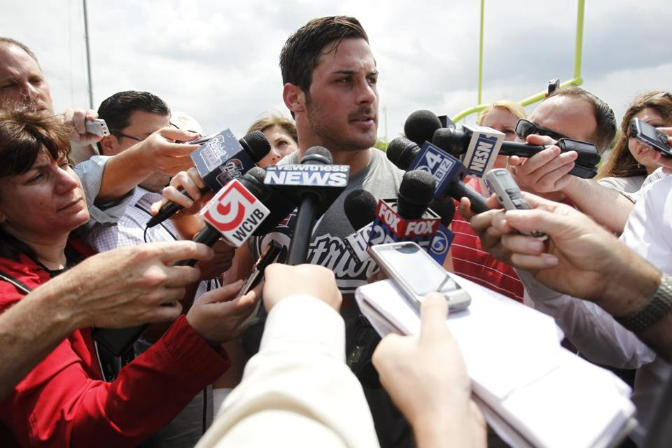 Receiver Danny Amendola was surrounded by reporters after practice Tuesday at Gillette Stadium.