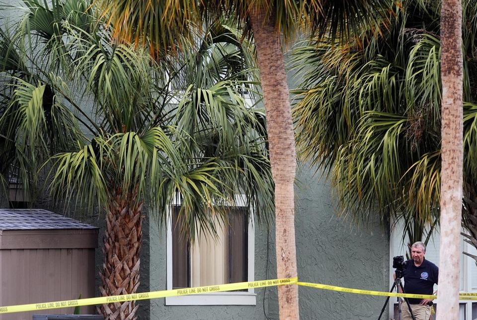 A member of an FBI evidence recovery team photographed the building following the shooting of Ibragim Todashev.