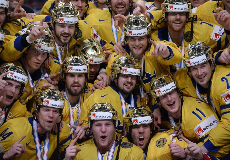 Sweden's players donned golden helmets after winning the hockey world championships.