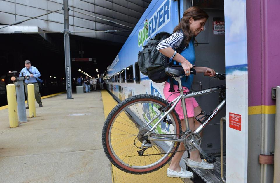 Kristin Nugent of Boston wheeled her bicycle on board the CapeFlyer in South Station, headed for Hyannis.