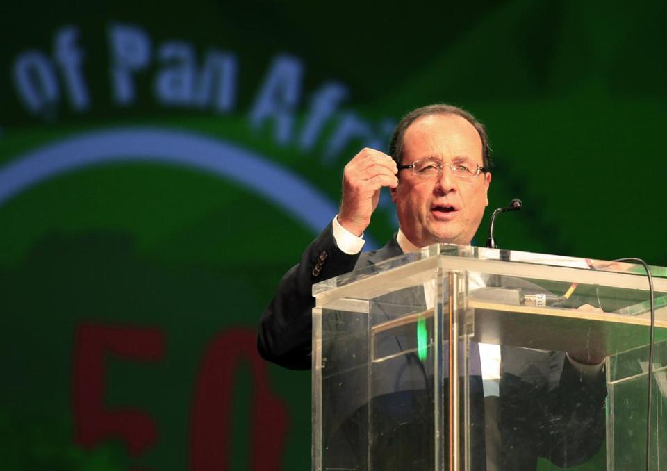 President Francois Hollande, in Ethiopia, said the Paris stabbing did not appear linked with the London attack.
