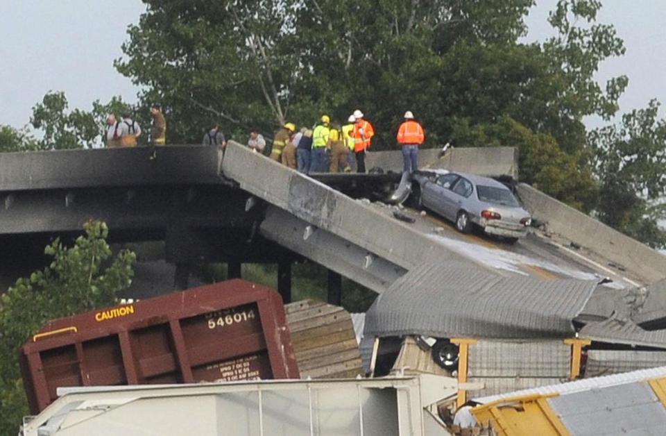Emergency workers inspected the scene of a train derailment and overpass collapse in Missouri.