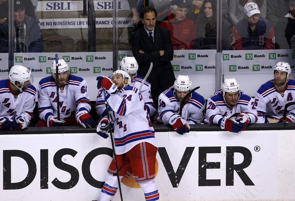 Coach John Tortorella stands behind a group of glum Rangers after the Bruins iced the game with a late empty-netter.