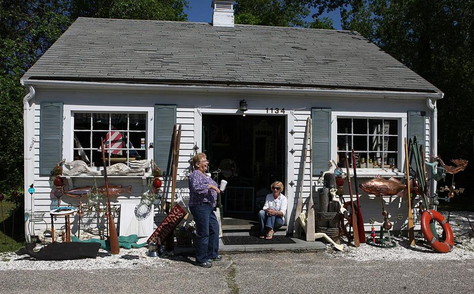 Carol Sherman, in the doorway to her Chatham business, Monomoy Salvage, Antiques & Gifts, talked to Sheryl Proctor of Drew's Sports Shop.