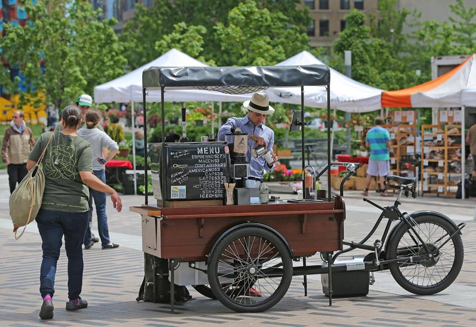 "Alessandro (""San"") Bellino working his coffee bar on wheels recently in Dewey Square."
