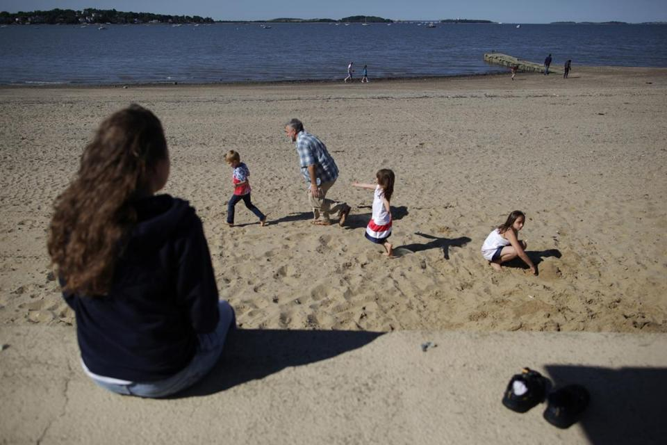 David J. Blaney played with his children on Wollaston Beach in Quincy June 14, 2012. Ten beaches on the South Shore were closed because of bacteria contamination, including Wollaston Beach.