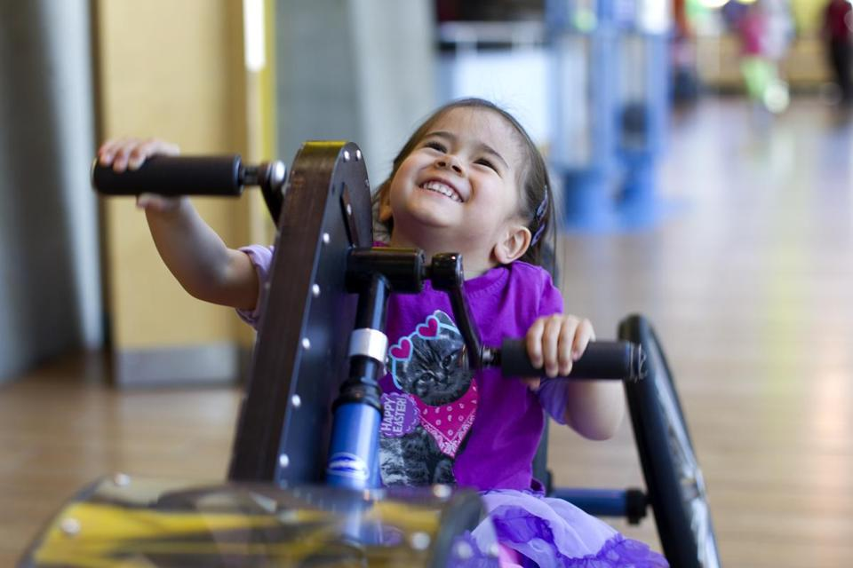 Violet O'Connell, 3, of Jamaica Plain has a blast onahand-powered cycle.