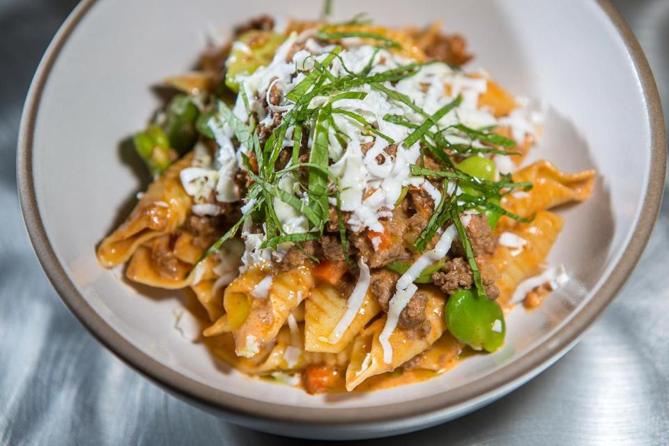Owner Felisha Foster's Spoke Wine Bar pays special attention to every detail, including dishes such as garganelli, made of pasta and lamb.