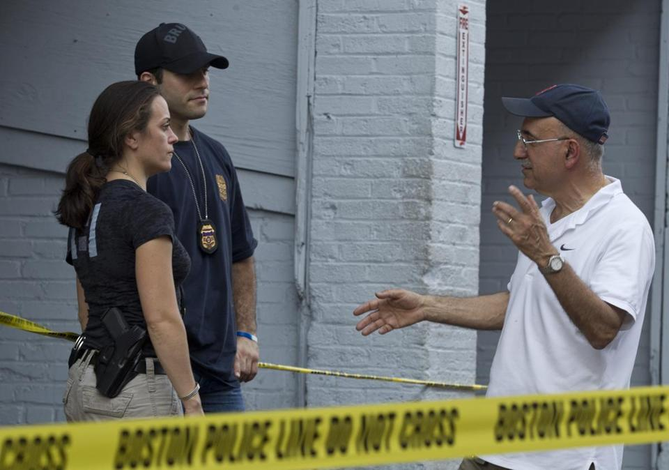 Federal agents spoke in May with Edward Tutunjian outside one of his garages on Kilmarnock Street in Boston.