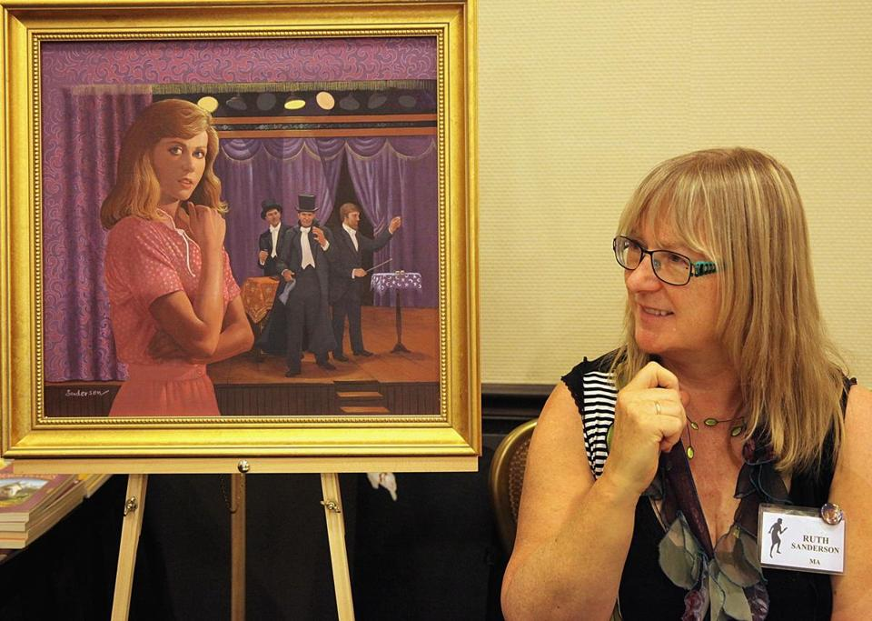 Illustrator Ruth Sanderson at the Nancy Drew Sleuths convention, with one of her paintings.