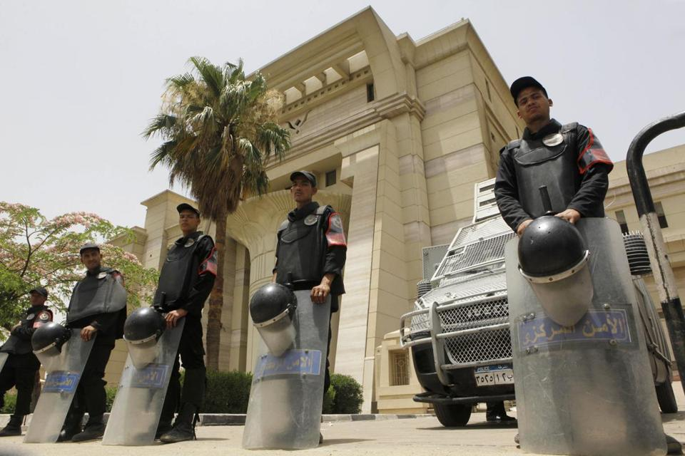Egyptian anti-riot police guarded the Supreme Constitutional Court in Cairo on Sunday. The court's ruling undermined the legitimacy of the only operating house of Parliament.