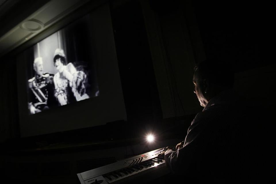 "Jeff Rapsis plays piano to accompany the 1926  Sidney Franklin film ""The Duchess of Buffalo,"" at the library in Manchester, N.H."