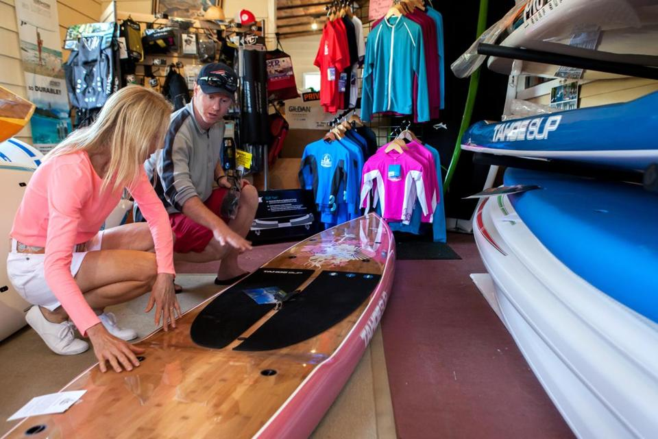 Justin Labdon helped Lynn Koch make a paddle board purchase.