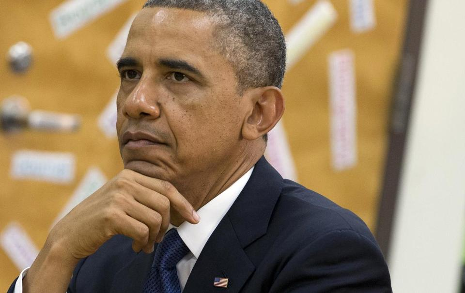 President Barack Obama viewed a math project during a tour of a middle school in Mooresville, N.C., Thursday.