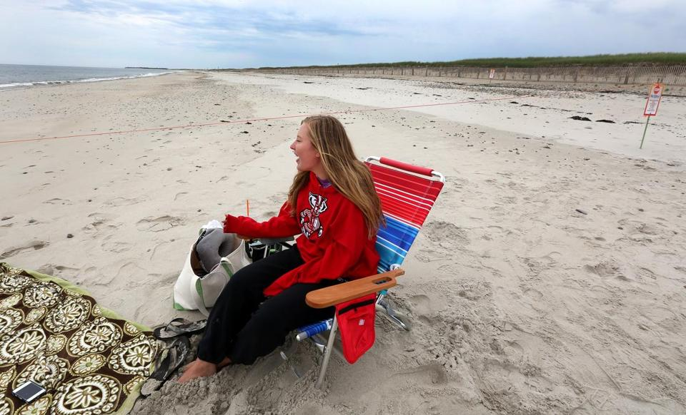 While piping plovers are nesting on Duxbury Beach, Sophie Dubuisson acts as a bird monitor, keeping people away from the threatened species.