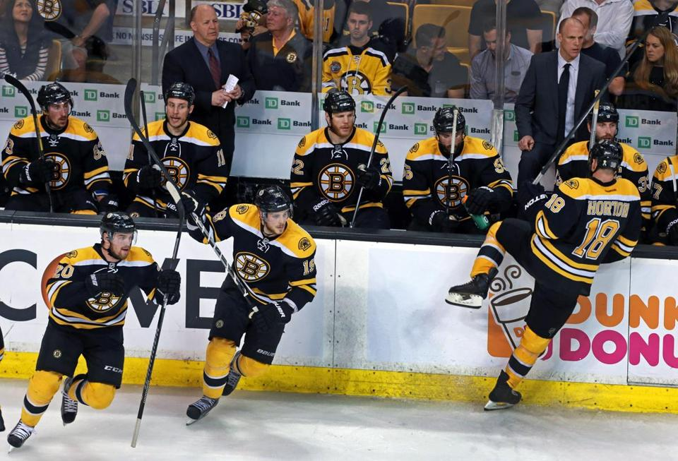 Coach Claude Julien (left), with help from assistant Doug Houda (right), determines when the Bruins make line changes.