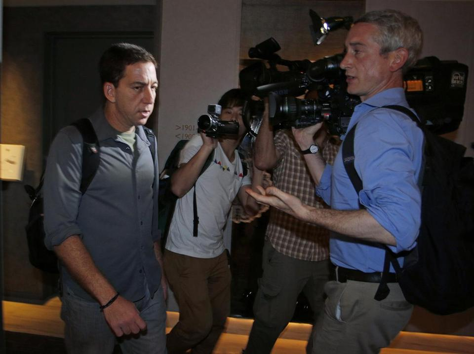 Glenn Greenwald, who interviewed Edward Snowden, faced members of the media outside his Hong Kong hotel room.