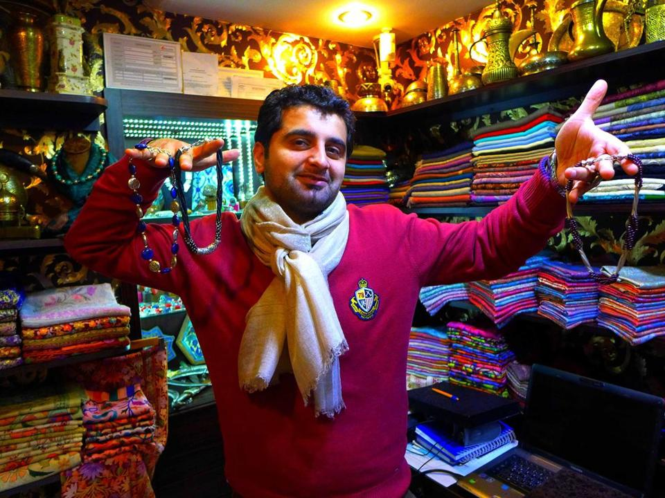 Good humor is part of the art of fair bargaining, like this merchant's attitude in Istanbul's Grand Bazaar.