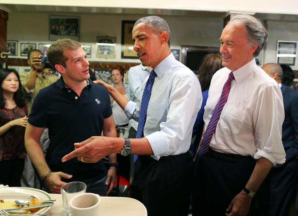 PresidentObama chated with a customer at Charlie's Sandwich Shoppe in the South End as Representative Edward Markey looked on.
