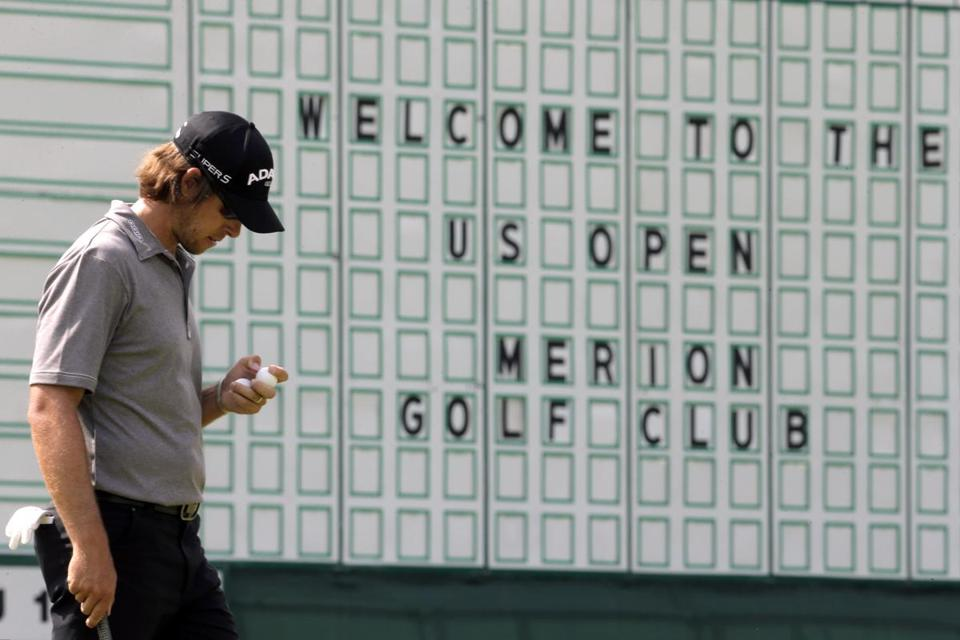 Aaron Baddeley, of Australia, walks on the 18th green during practice for the US Open at Merion Golf Club.