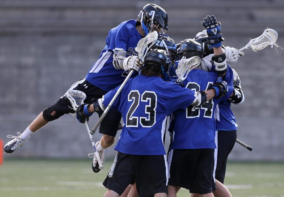 Dover-Sherborn players celebrated a first half goal against Cohasset.