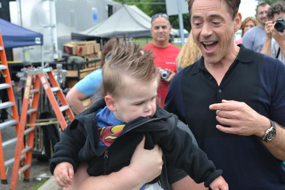 Robert Downey Jr. smiles at young Jaxson Denno, and then comforts him when he starts to cry.