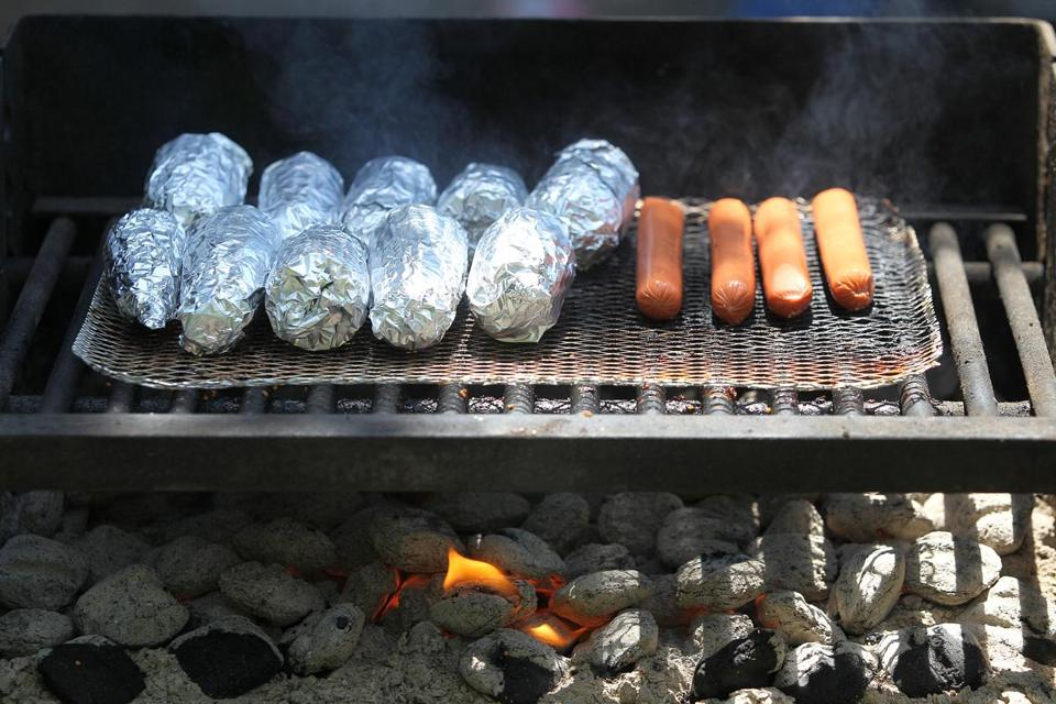 Food cooked over a grill as people picniced at Houghton's Pond in Milton.