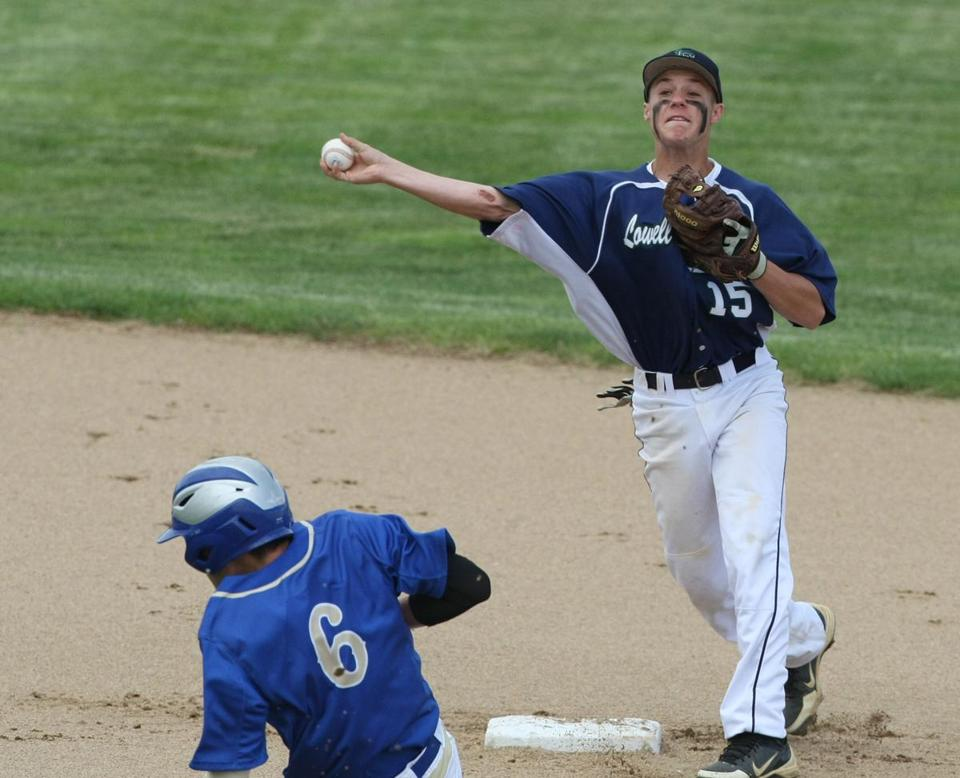 Lowell Catholic's James Sullivan completes a double play, as Pope John Paul II's Brady Jones is too late on the slide.